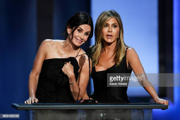 Courteney Cox and Jennifer Aniston speak onstage during the American Film Institute's 46th Life Achievement Award Gala Tribute to George Clooney at...