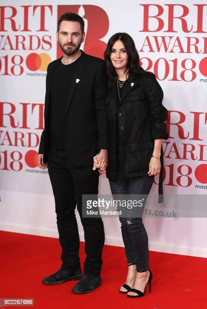 AWARDS 2018 *** Courteney Cox and Johnny McDaid attend The BRIT Awards 2018 held at The O2 Arena on February 21 2018 in London England