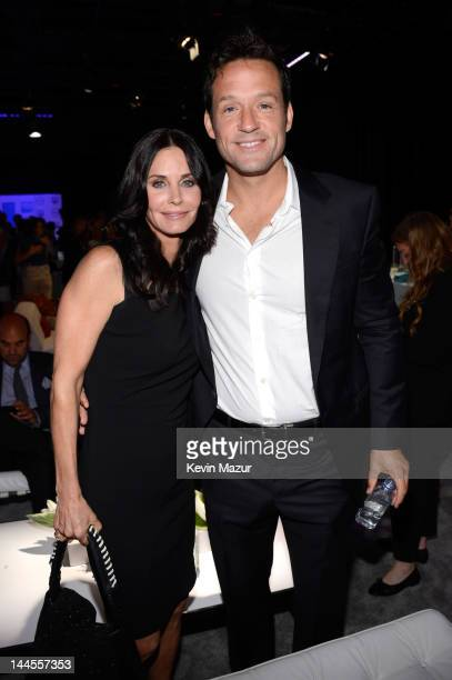 Courteney Cox and Josh Hopkins attend the TNT/ TBS Upfront 2012 at Hammerstein Ballroom on May 16 2012 in New York City 22362_001_0017JPG