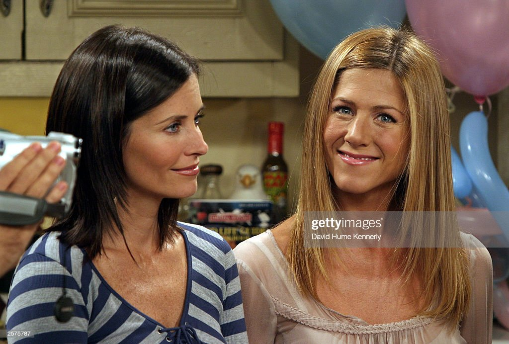 Courteney Cox Arquette (L) and Jennifer Aniston smile on the set of the hit NBC series 'Friends' during one of their last shows on the Warner Bros lot Sept. 12, 2003 in Burbank, CA. 'Friends,' which is in its ninth and final season, debuted in 1994, has won 44 Emmys, and is one of the biggest successes in television history. (Photo by David Hume Kennerly/Getty Images) This image is not included in any subscription deal. Use of this image will incur a charge.