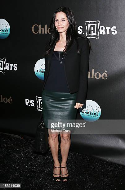 Courteney Cox arrives at The Los Angeles Modernism show and sale to benefit PS ARTS held at Barker Hangar on April 25 2013 in Santa Monica California
