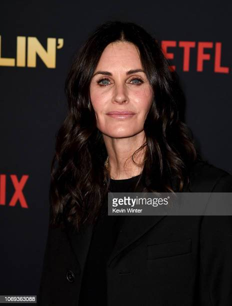 Courteney Cox arrives at the premiere of Netflix's Dumplin' at the Chinese Theater on December 6 2018 in Los Angeles California