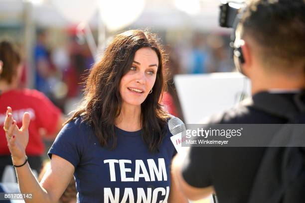 Courteney Cox attends the Nanci Ryder's 'Team Nanci' participates in the 15th Annual LA County Walk to Defeat ALS at Exposition Park on October 15...