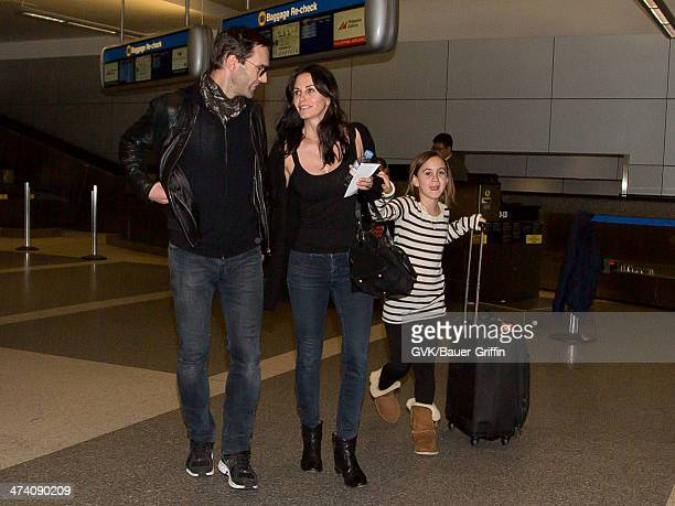 Courteney Cox Johnny McDaid and daughter Coco Arquette are seen at LAX airport on February 21 2014 in Los Angeles California
