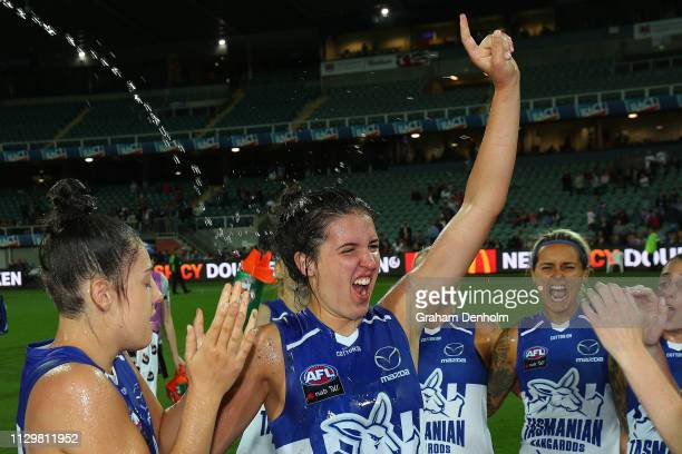 Courteney Munn of the Kangaroos and her teammates celebrate victory in the round three AFLW match between the North Melbourne Kangaroos and the...
