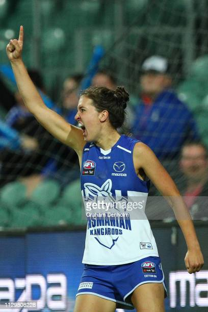 Courteney Munn of the Kangaroos celebrates kicking a goal during the round three AFLW match between the North Melbourne Kangaroos and the Western...