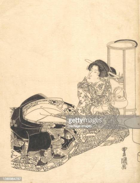 Courtesan or Actor as Courtesan Pouring Tea by the Light of a Lantern. Artist Utagawa Toyokuni I.
