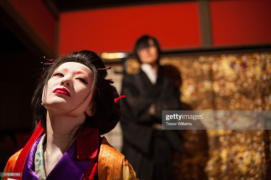 A courtesan performance in the Shimabara, or red light district, during the Uzumasa Edosakaba, an event recreating an edo-period bar at the Toei Kyoto Studio Park on May 30, 2015 in Kyoto, Japan. The Toei Kyoto Studio Park, a studio park built next to a working film set, turned itself into a big edo-period bar where people can drink and enjoy edo period culture including Japanese cuisine and samurai sword fighting.