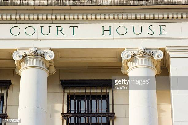 courthouse sign and architectural columns of legal system building exterior - geometrical architecture stock photos and pictures