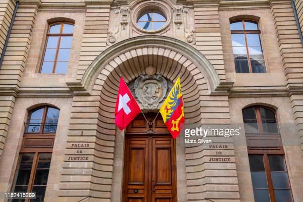 courthouse with flags in entrance - geneva switzerland stock pictures, royalty-free photos & images