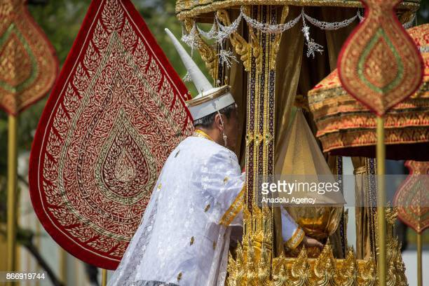 Courtier is seen taking part of the Royal Ceremony as he holding the Thailand's Late King Bhumibol Adulyadej's Royal Ashes to be taken into the Dusit...