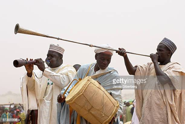 Courtiers herald the arrival of an Emir at the Argungu Fishing Festival March 18 2004 in Argungu Nigeria The Argungu Fishing Festival was first held...