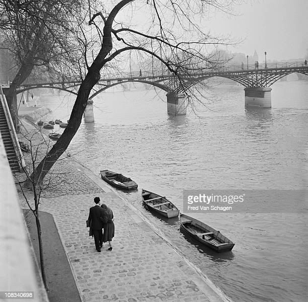 A courting couple walking on the bank of the Seine Paris 1954