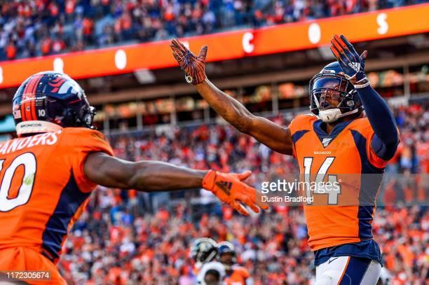 Courtland Sutton and Emmanuel Sanders of the Denver Broncos celebrate after a fourth quarter Sutton touchdown against the Jacksonville Jaguars at...