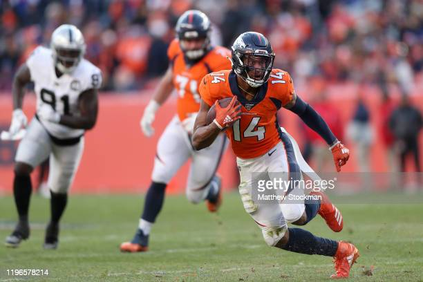 Courtland Sutton of the Denver Broncos carries the ball after making a reception against the Oakland Raiders in the second quarter at Empower Field...