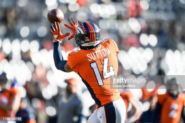 Courtland Sutton of the Denver Broncos catches a ball as he warms up before a game against the Oakland Raiders at Empower Field at Mile High on...