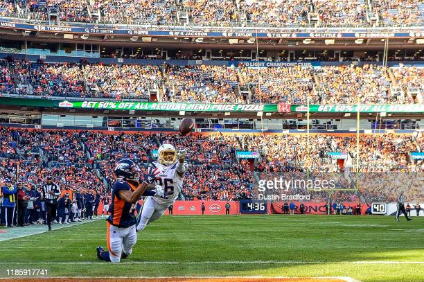 Courtland Sutton of the Denver Broncos catches a first quarter touchdown reception under coverage by Casey Hayward Jr. #26 of the Los Angeles...