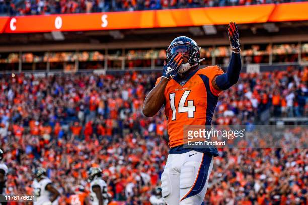 Courtland Sutton of the Denver Broncos celebrates after a fourth quarter touchdown reception against the Jacksonville Jaguars at Empower Field at...