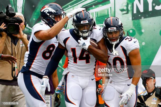 Courtland Sutton of the Denver Broncos celebrates with his teammates after scoring an 8 yard touchdown against the New York Jets during the first...