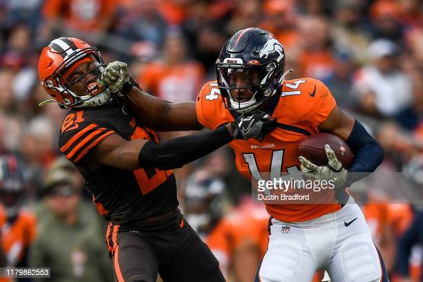 Courtland Sutton of the Denver Broncos gives a stiff arm to Denzel Ward of the Cleveland Browns after a first quarter reception at Empower Field at...