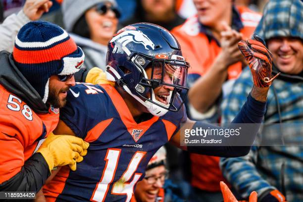 Courtland Sutton of the Denver Broncos is congratulated by fans after a first quarter touchdown catch against the Los Angeles Chargers at Empower...