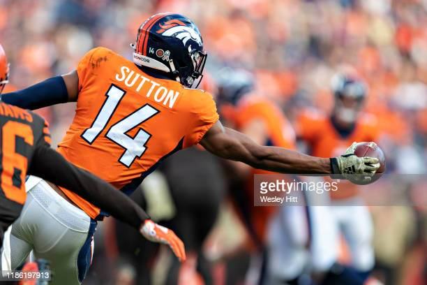 Courtland Sutton of the Denver Broncos misses a pass thrown behind him that hits him in the palm during a game against the Cleveland Browns at...