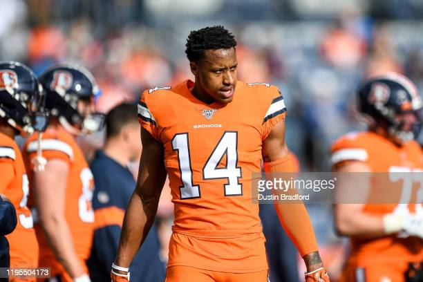 Courtland Sutton of the Denver Broncos stands on the field as he warms up before a game against the Detroit Lions at Empower Field at Mile High on...