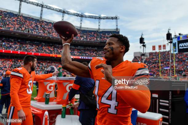 Courtland Sutton of the Denver Broncos throws the ball as he warms up in the bench area before the start of a game against the Detroit Lions at...