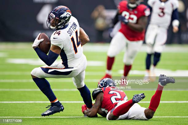 Courtland Sutton of the Denver Broncos tries to get away from the tackle of Johnathan Joseph of the Houston Texans during the second half at NRG...