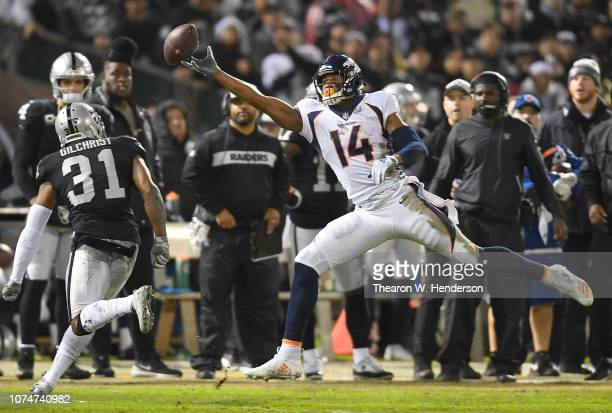 Courtland Sutton of the Denver Broncos watches the pass go off his fingertips against the Oakland Raiders during the first half of their NFL football...