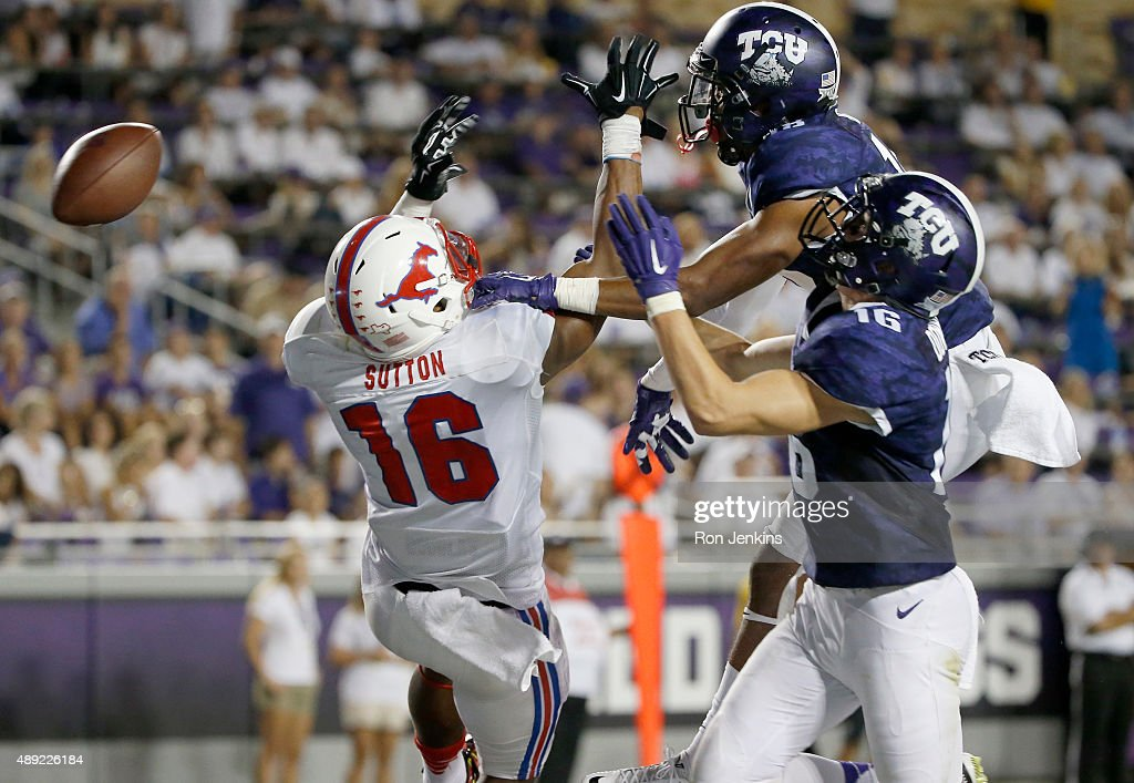 Courtland Sutton #16 of the Southern Methodist Mustangs has a pass knocked away by Michael Downing #16 of the TCU Horned Frogs and his teammate Nick Orr #18 in the second half at Amon G. Carter Stadium on September 19, 2015 in Fort Worth, Texas.