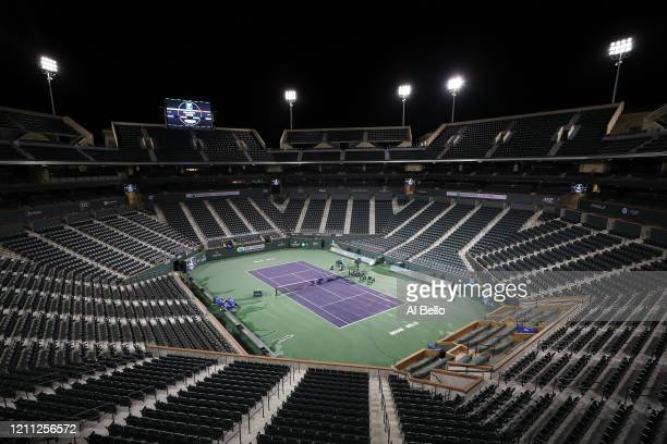 Courtmaster Jeffrey Brooker cleans the center court at the Indian Wells Tennis Garden on March 08, 2020 in Indian Wells, California. The BNP Paribas...