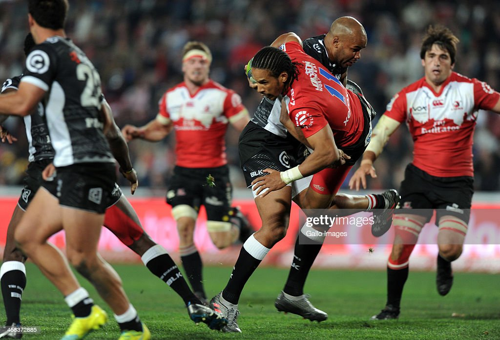 Courtnall Skosan of Lions in action with JP Pietersen of Sharks during the Super Rugby match between Emirates Lions and Cell C Sharks at Emirates Airline Park on July 02, 2016 in Johannesburg, South Africa.