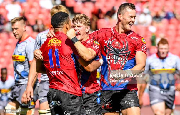 Courtnall Skosan of the Lions celebrates with teammates after scoring a try during the Super Rugby match between Emirates Lions and DHL Stormers at...