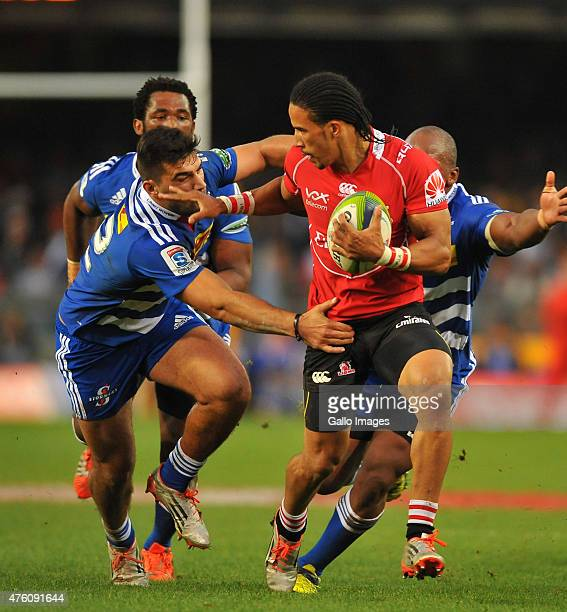 Courtnall Skosan of the Lions hands off Damian de Allende of the Stormers during the Super Rugby match between DHL Stormers and Emirates Lions at DHL...