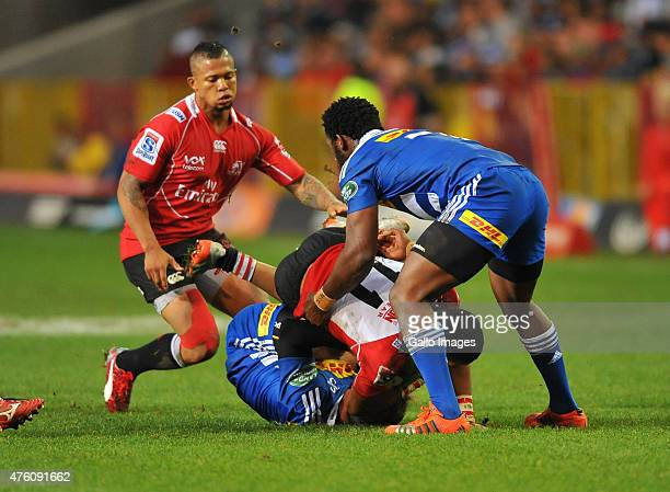 Courtnall Skosan of the Lions hands off Nic Groom of the Stormers during the Super Rugby match between DHL Stormers and Emirates Lions at DHL...