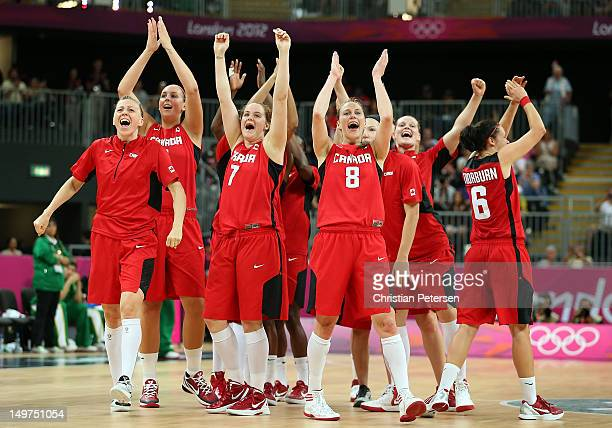 Courtnay Pilypaitis and Kim Smith of Canada celebrate with teammates after defeating Brazil in the Women's Basketball Preliminary Round match on Day...