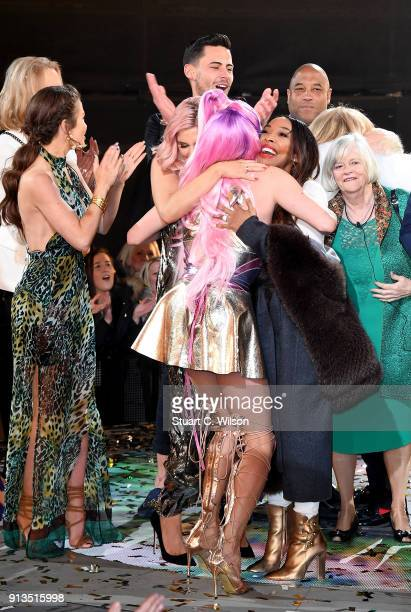 Courtney Act hugs fellow housemate Malika Haqq as she is crowned winner during the 2018 Celebrity Big Brother Final at Elstree Studios on February 2...