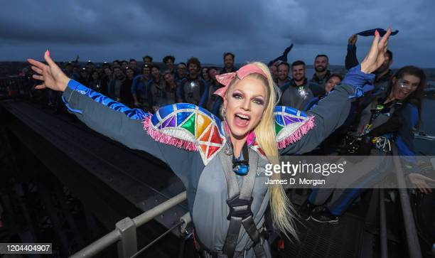 Courtney Act in a group photo with other climbers on top of Bridgeclimb at the Sydney Harbour Bridge on February 06 2020 in Sydney Australia The...