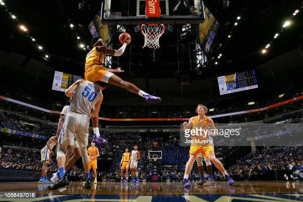 Courtney Alexander II of the Tennessee Tech Golden Eagles drives to the basket against David Wingett of the Memphis Tigers on November 6 2018 at...