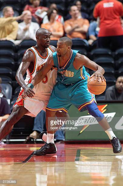 Courtney Alexander of the New Orleans Hornets dribbles against Dion Glover of the Atlanta Hawks during the game at Philips Arena on November 3 2003...