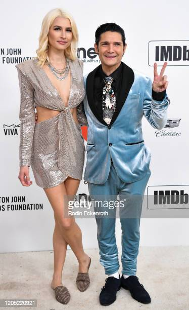 Courtney Anne Mitchell and Corey Feldman attend the 28th Annual Elton John AIDS Foundation Academy Awards Viewing Party Sponsored By IMDb And Neuro...