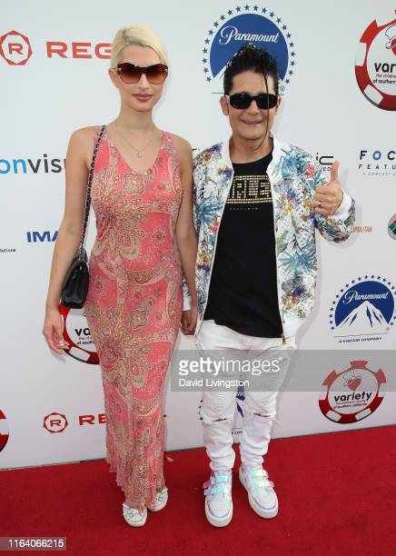 Courtney Anne Mitchell and Corey Feldman attend the 9th Annual Variety The Children's Charity Poker and Casino Night at Paramount Studios on July 24...