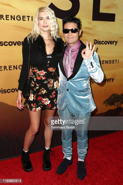 Courtney Anne Mitchell and Corey Feldman attend the Los Angeles Special Screening Of Discovery's Serengeti at Wallis Annenberg Center for the...