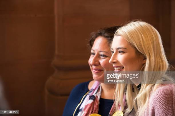 Courtney Anne Mitchell wife of Corey Feldman poses for a photograph after attending a press conference in support of the Child Victims Act in which...