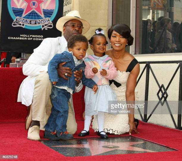 Courtney B Vance Angela Bassett and their children attend the ceremony honoring her with a star on the Hollywood Walk of Fame on March 20 2008 in...
