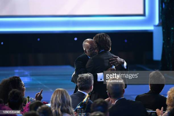 """Courtney B Vance congratulates Jason Bateman as he accepts Outstanding Performance by a Male Actor in a Drama Series for """"Ozark"""" during the 25th..."""