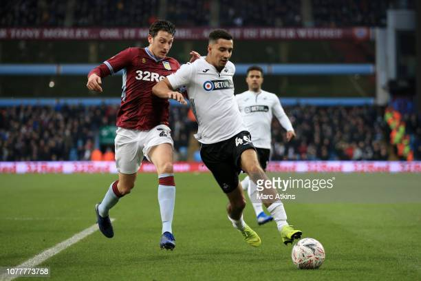 Courtney BakerRichardson of Swansea City battles for possession with Tommy Elphick of Aston Villa during the FA Cup Third Round match between Aston...