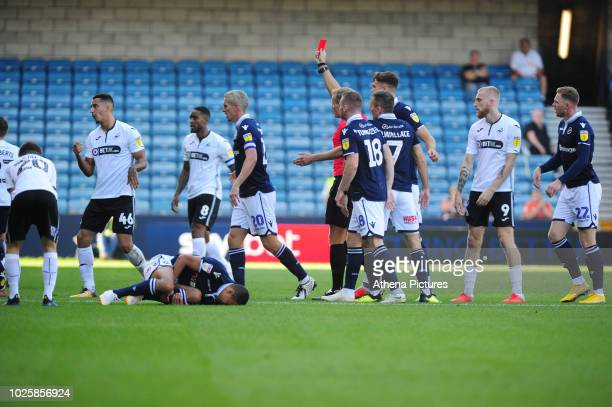 Courtney BakerRichardson of Swansea City is shown a red card by Todays match referee Graham Scott during the Sky Bet Championship match between...