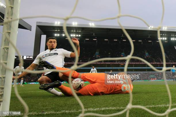 Courtney BakerRichardson of Swansea City scores his team's first goal past Lovre Kalinic of Aston Villa during the FA Cup Third Round match between...
